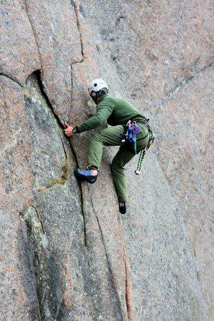 lofoten: man climbing mountain, Lofoten Norway
