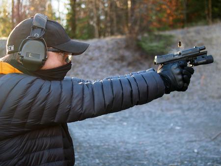 glock: Man shooting handgun