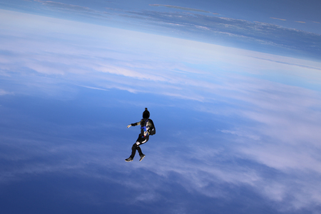 Skydiving over beautiful Norway. Clouds, sun and sky