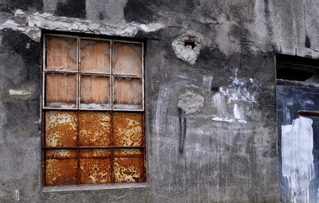 iron oxide: Rusty vintage window and door in urban scene Stock Photo