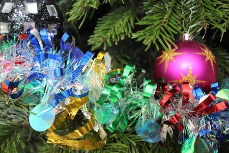 Multi-coloured tinsel on a Christmas tree.