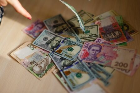 hryvna: Ukrainian money hryvnia and usa dollars. The national currency. Stock Photo
