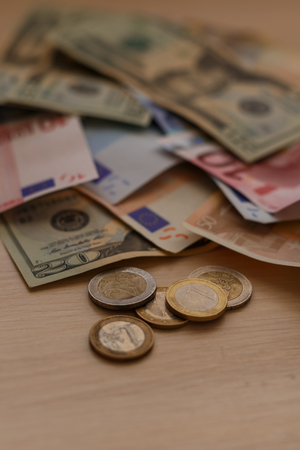 international crisis: Cash on table isolated: dollars, euro broken money All in mess, global crisis concept