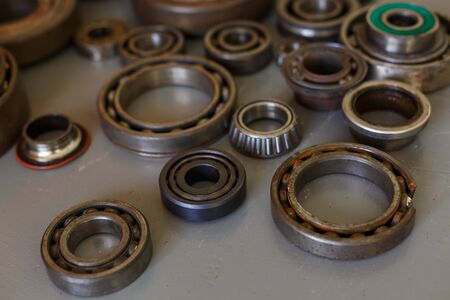 old bearings on a wooden background close up Two old rusty bearing