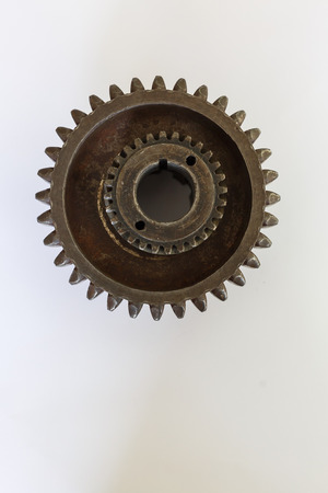 real stainless steel gears isolated over white background Old rusty cog gear wheel
