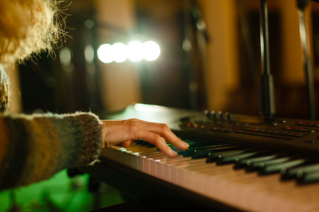 woman playing on electric piano pianist music Stock Photo