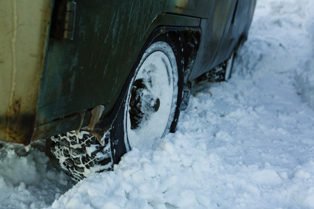 The car got stuck in the snow car wheel deep in snow Reklamní fotografie