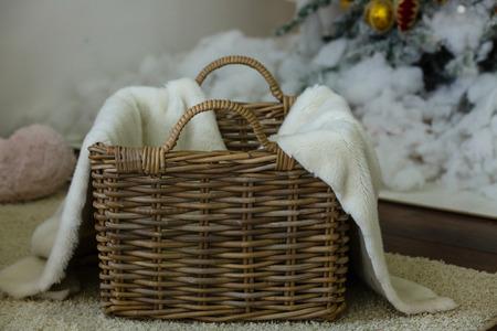 Fur blanket in the basket Cute Sleeping Newborn Baby In A Brown Basket
