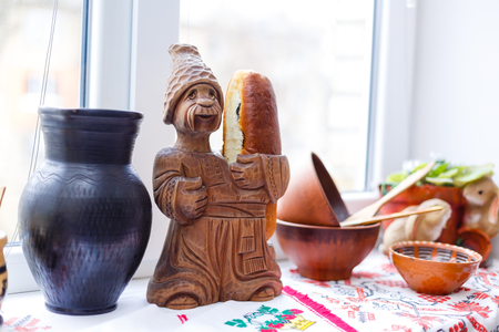 Ukrainian man and woman figurine handmade from clay selective focus