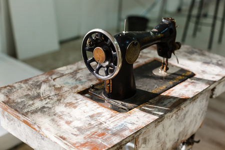 textile industry: The old sewing machine on a white background