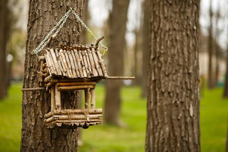 Bird feeder made of twigs Stock Photo