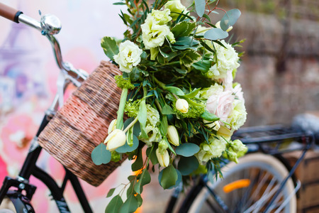 The bicycle and the roses flower bouquet