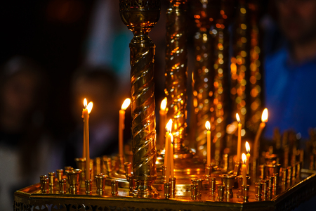 introversion: ambiance of church, candles and bokeh yellow lights