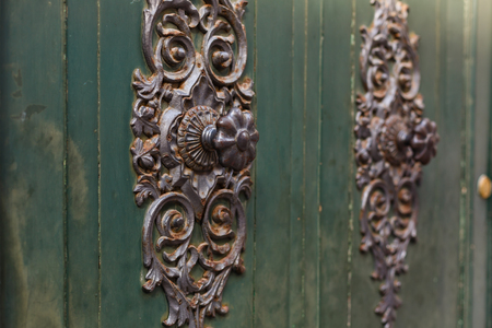 Detail of beautiful, ornate door knocker on an antique portal.