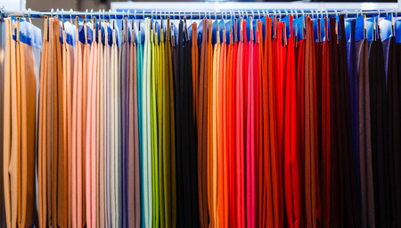 Closeup of colorful scarves hanging in the market. Archivio Fotografico