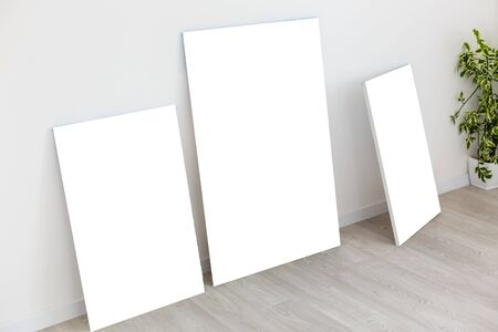 Mockup photo canvas in interior. Empty canvas for design. White brick wall on background.