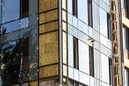 Building facade renovation, house reconstruction, repair. Banco de Imagens