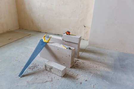 Interior of apartment with materials during on the renovation and construction (remodel wall from gypsum plasterboard or drywall)