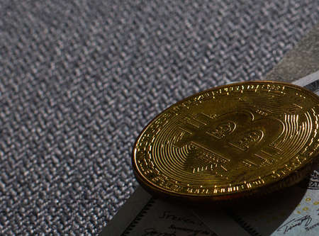 Photo Golden Bitcoins new virtual money cryptocurrency and banknotes of one US dollar Standard-Bild - 161766653