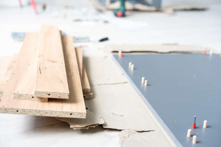 Assembling furniture installation of shelves with new apartment a shelf new home construction of interior room