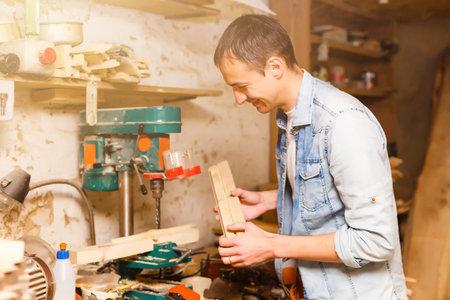 Carpenter works in a workshop for the production of vintage furniture