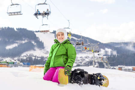 Little Cute Girl Snowboarding at ski resort in sunny winter day. Caucasus Mountains. Mount Hood Meadows Oregon