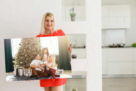 Canvas prints. A woman holding photo canvas. photo printed on glossy synthetic canvas and stretched on wooden stretcher bar