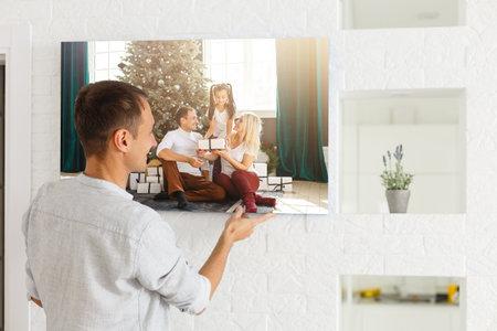 man holds photo canvas at home Standard-Bild