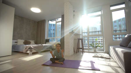 little cute girl do a yoga at home with space for add text
