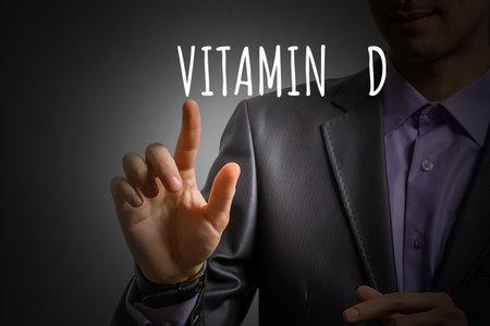 businessmans hand shows vitamin d Standard-Bild