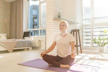 Young woman at home stretching out after exercising Standard-Bild