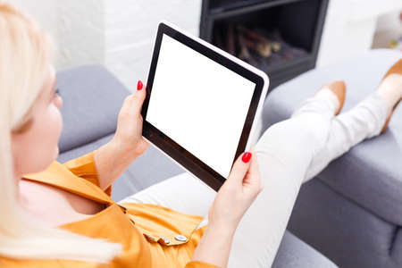Business woman holding blank touch screen device.
