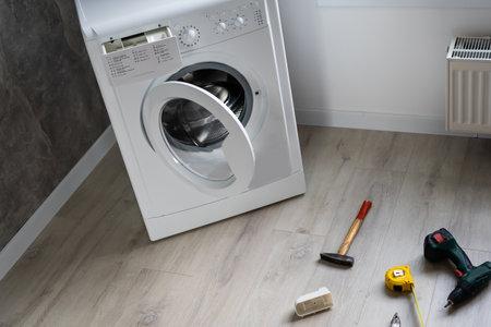 broken washing machine in the apartment