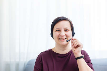 Headshot portrait of smiling young woman. girl with happy facial expression looking at camera with joy, communicating with friends via internet telephony, making video call. Close up. Front view