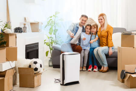 family with an air purifier moving to a new apartment