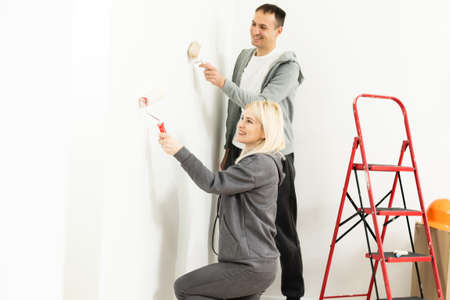 Couple redecorating home, couple makes repairs in the apartment