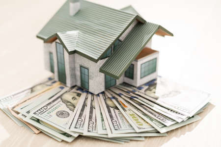 the layout of the house is on a pile of money