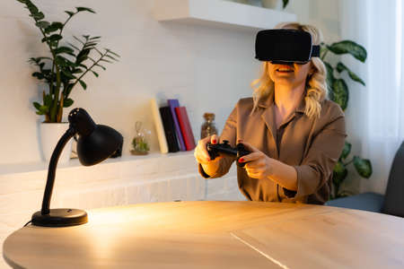 Woman play game with VR device at home