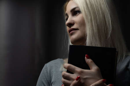 A close-up of a christian woman reading the bible Stock Photo
