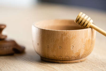A spoon of honey on the wood plate