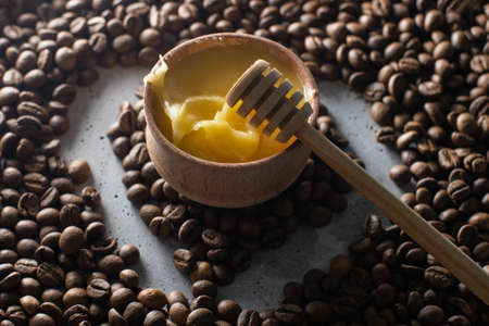 honey and coffee beans on wood background, abstract