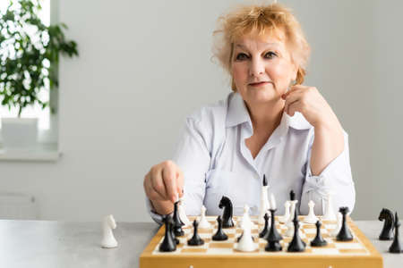 close-up view of elderly woman playing chess