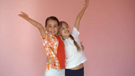 Two little schoolgirls. Education, fashion, friendship concept.