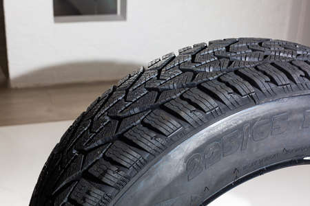 winter tire on gray background