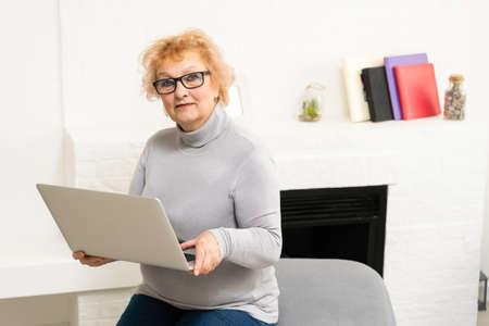 Senior woman working on her laptop, elderly woman Stock Photo