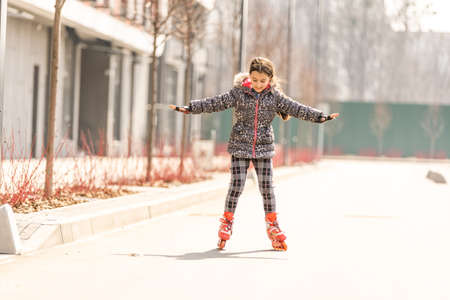 Cute little girl rollerblading. sports and entertainment.