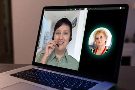 Virtual meeting online. Video conference by laptop. Online business meeting. On the laptop screen, people who gathered in a video conference to work on-line