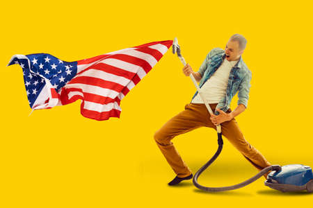 man vacuums the usa flag