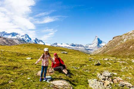 Family trekking, mother and daughter camping 版權商用圖片