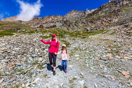 Family trekking, mother and daughter camping